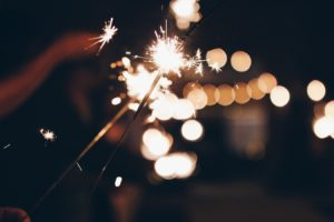Sparklers at night.