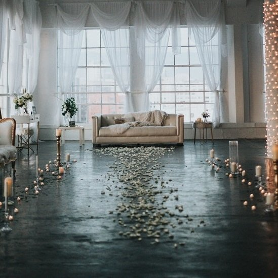 empty room with couch and white rose petals.