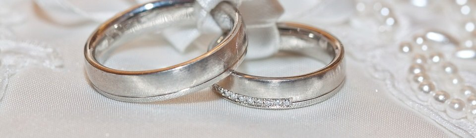 Silver rings on white surface.